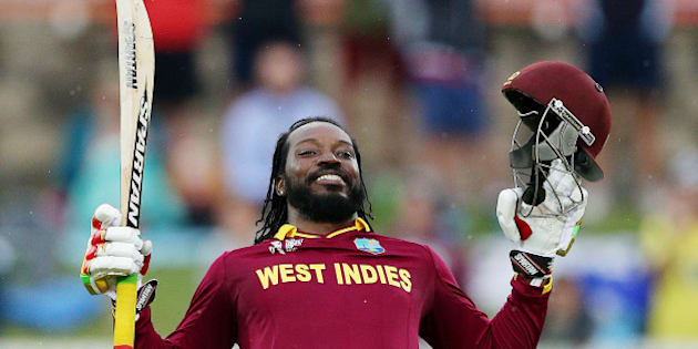 West Indies batsman Chris Gayle celebrates after scoring a double century during their Cricket World  Cup Pool B match against Zimbabwe in Canberra, Australia, Tuesday, Feb. 24, 2015. (AP Photo/Rob Griffith)