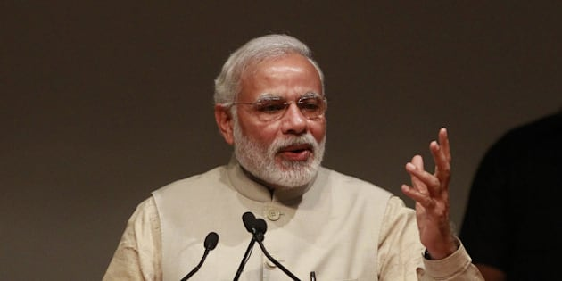 NEW DELHI, INDIA - FEBRUARY 23: Prime Minister Narendra Modi addresses a gathering at the inauguration of International Ramayana Mela at FICCI Auditorium on February 23, 2015 in New Delhi, India.  Addressing the event the, Prime Minister said that world affairs are no longer on one track. Soft power is becoming increasingly critical in world affairs across the world and India should leverage its great traditions and culture in forging ties with countries around the world in a way that is deeper, more personal, and therefore, far more powerful. (Photo by Sanjeev Verma/Hindustan Times via Getty Images)