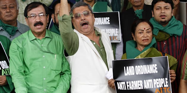 NEW DELHI, INDIA - FEBRUARY 24: Trinamool Congress MPs staged a protest against the Land Acquisition Bill outside the Parliament during budget session on February 24, 2015 in New Delhi, India. The government introduced the land acquisition amendment bill in the Lok Sabha amid an uproar by the opposition. (Photo by Arvind Yadav/Hindustan Times via Getty Images)