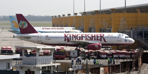 Kingfisher Airlines jets parked at the Indira Gandhi international airport in New Delhi, India, Tuesday, Oct. 2, 2012. Kingfisher Airlines grounded flights for at least three days after a violent strike over unpaid wages at the cash-strapped Indian carrier. (AP Photo/Tsering Topgyal)