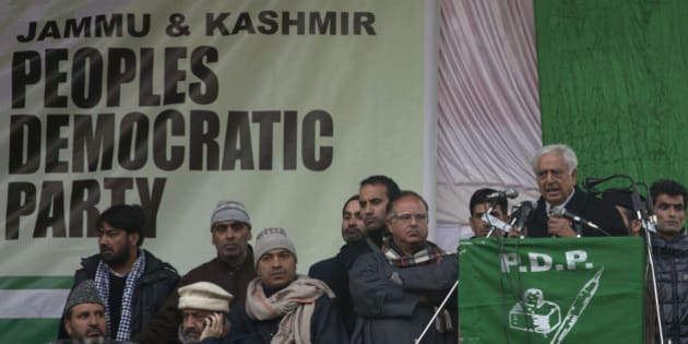 Peoples Democratic Party (PDP) leader Mufti Mohammad Sayeed, right, addresses an election campaign rally in Srinagar, Indian controlled Kashmir, Thursday, Dec. 11, 2014.  The final two phases of the five-phased state elections of Jammu and Kashmir will be held on Dec. 14 and 20. (AP Photo/Dar Yasin)