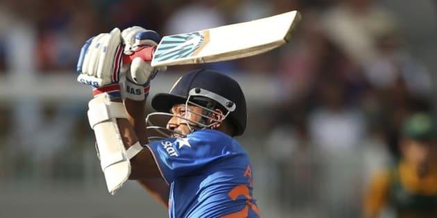 India's Ajinkya Rahane, plays a shot during their Cricket World Cup pool B match against South Africa in Melbourne, Australia, Sunday, Feb. 22, 2015. (AP Photo/Rick Rycroft)