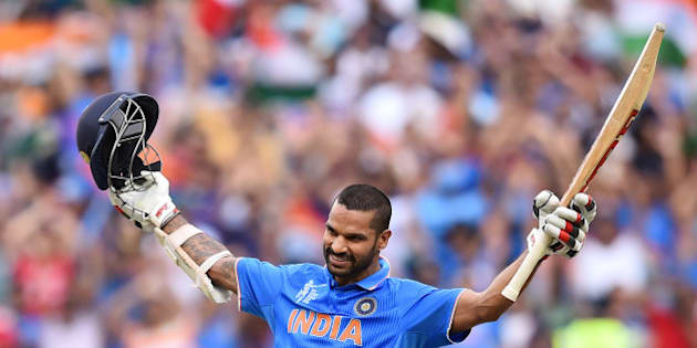 India's Shikhar Dhawan celebrates after scoring a century against South Africa during their Cricket World Cup pool B match in Melbourne, Australia, Sunday, Feb. 22, 2015. (AP Photo/Theo Karanikos)