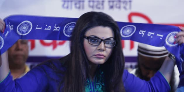 MUMBAI, INDIA - JUNE 28: Bollywood actor turned poltician Rakhi Sawant after she joined Republican Party of India (RPI) in the presence of party Chief Ramdas Athavale at MIG Club on June 28, 2014 in Mumbai, India. She was made the national executive president of RPI womens wing. Just before the 2014 Lok Sabha elections, Sawant supported the BJP and Narendra Modi.  However, when the BJP overlooked her for a ticket, Sawant floated her own political party Rashtriya Aam Party and contested the polls from the Mumbai North-West constituency, securing just 1,995 votes. (Photo by Satish Bate/Hindustan Times via Getty Images)