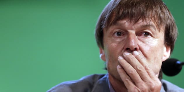 French TV host and environmental campaigner Nicolas Hulot listens during a press conference, on June 27, 2012, at the headquarters of France's Economic, Social and Environmental Council (CESE) in Paris, to launch a campaign of French NGOs called 'Urges End to Fossil Fuel Subsidies', headed by the Nicolas Hulot Foundation and the Climate Action Network France (RAC-F). AFP PHOTO KENZO TRIBOUILLARD        (Photo credit should read KENZO TRIBOUILLARD/AFP/GettyImages)