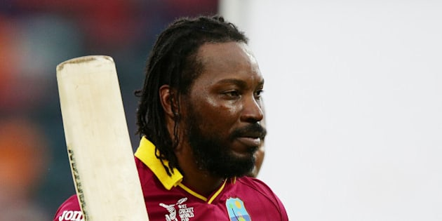 West Indies batsman Chris Gayle waves his bat as he leaves the field after scoring 215 runs during their Cricket World  Cup Pool B match against Zimbabwe in Canberra, Australia, Tuesday, Feb. 24, 2015. (AP Photo/Rob Griffith)