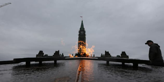 OTTAWA, ON - NOVEMBER 10:Tourists visit the Centennial Flame, lit in 1967 by Lester B. Pearson burns on Parliament Hill. Preparations are under way War Memorial on the eve of Remembrance Day.        (Steve Russell/Toronto Star via Getty Images)
