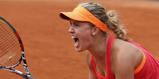 Canada's Eugenie Bouchard reacts as she defeats Spain's Carla Suarez Navarro during their quarterfinal match of  the French Open tennis tournament at the Roland Garros stadium, in Paris, France, Tuesday, June 3, 2014. Bouchard won 7-6, 2-6, 7-5.  (AP Photo/David Vincent)
