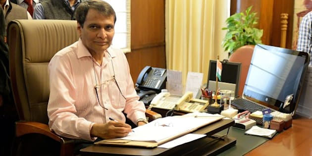 Indian Railway Minister Suresh Prabhu poses for the media while giving the final touches to the Railway Budget in New Delhi on February 25, 2015.  Union Railway Minister will table the railway budget in parliament on 26 February.  AFP PHOTO / PRAKASH SINGH        (Photo credit should read PRAKASH SINGH/AFP/Getty Images)