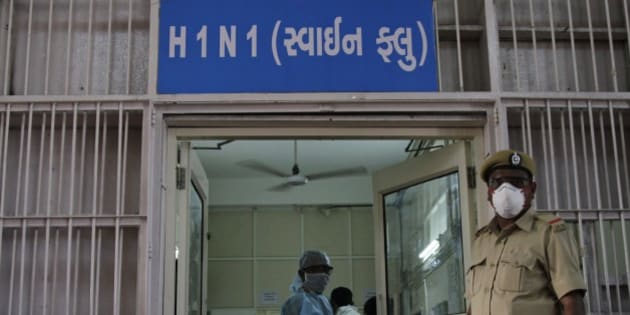 "A security man stands outside an isolation ward for swine flu at the Civil Hospital in Ahmadabad, India, Wednesday, Feb. 25, 2015.The west Indian city has banned large public gatherings in an attempt to halt the spread of swine flu, which has claimed more than 900 lives nationwide in 11 weeks. Gujarati reads, ""Swine Flu"".(AP Photo/Ajit Solanki)"