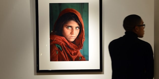 'Afghan Girl, 1984' by photographer Steve McCurry (estimate- USD $30,000 to $50,000) on display as part of 'The National Geographic Collection: The Art of Exploration' at Christie's November 30, 2012 in New York. Fine art from the archives of the National Geographic Society will be auctioned on December 6. AFP PHOTO/Stan HONDA        (Photo credit should read STAN HONDA/AFP/Getty Images)