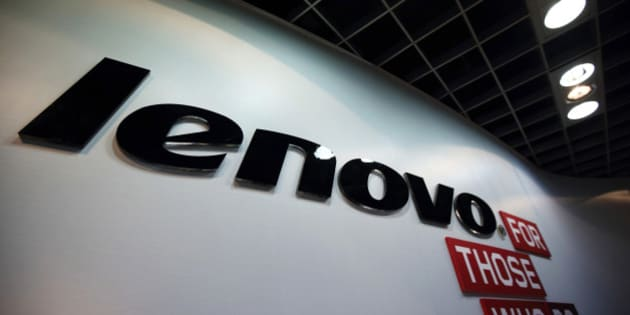 The Lenovo Group Ltd. logo is displayed in the company's headquarters in Beijing, China, on Tuesday, Nov. 11, 2014. Lenovo Chief Executive Officer Yang Yuanqing has expanded in computer servers and mobile phones, including the $2.91 billion purchase of Motorola Mobility, to help combat a shrinking personal-computer market. Photographer: Tomohiro Ohsumi/Bloomberg via Getty Images