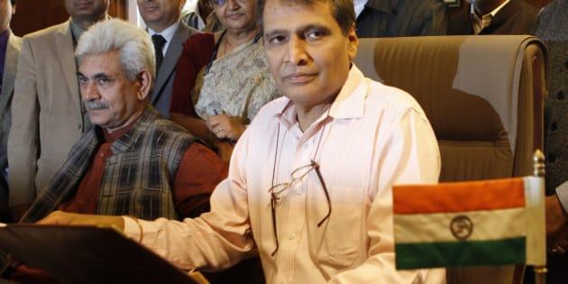 NEW DELHI, INDIA - FEBRUARY 25: Railway Minister Suresh Prabhakar Prabhu with MOS Manoj Sinha and their team members giving final touches to the Railway Budget 2015-16 at Railway Ministers Chamber, Rail Bhawan on February 25, 2015 in New Delhi, India. Union Railway Minister Suresh Prabhu will be presenting the 2015-16 Railway Budget in the Parliament on February 26. This will be Prime Minister Narendra Modi-led NDA Governments first railway budget. (Photo by Virendra Singh Gosain/Hindustan Times via Getty Images)
