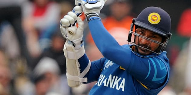 Sri Lanka's Kumar Sangakkara drives the ball against New Zealand during the opening match of the Cricket World Cup at Christchurch, New Zealand, Saturday, Feb. 14, 2015. (AP Photo/Ross Setford)
