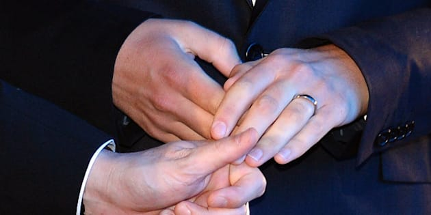 The hands of Bruno Boileau and Vincent Autin are pictured as they exchange their wedding rings during their marriage, France's first official gay marriage, in the city hall in Montpellier on May 29, 2013. France is the 14th country to legalise same-sex marriage, an issue that has also divided opinion in many other nations. The definitive vote in the French parliament came on April 23 when the law was passed legalising both homosexual marriages and adoptions by gay couples.  AFP PHOTO / GERARD JULIEN        (Photo credit should read GERARD JULIEN/AFP/Getty Images)