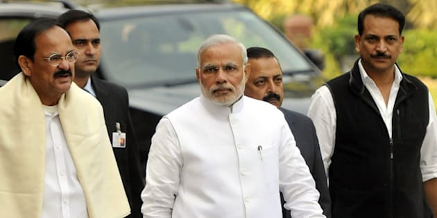 NEW DELHI, INDIA- NOVEMBER 24: Prime Minister Narendra Modi walks with Minister of Urban Development and Parliamentary Affairs Venkaiah Naidu, Minister of State Skill Development & Entrepreneurship (Independent Charge) Rajiv Pratap Rudy, Dr. Jitendra Singh, Minister of Science and Technology during the opening day of the winter session of Parliament on November 24, 2014 in New Delhi, India. The Narendra Modi government, which has promised big reforms in its first budget, is looking to push the Insurance Bill as well as the Goods and Service Tax Bill in the month-long winter session that begins today. (Photo by Vipin Kumar/ Hindustan Times via Getty Images)