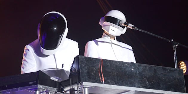 INDIO, CA - APRIL 20:  Guests dressed as Daft Punk perform with Arcade Fire live onstage to close out the 2014 Coachella Valley Music And Arts Festival  at The Empire Polo Club on April 20, 2014 in Indio, California.  (Photo by C Flanigan/FilmMagic)