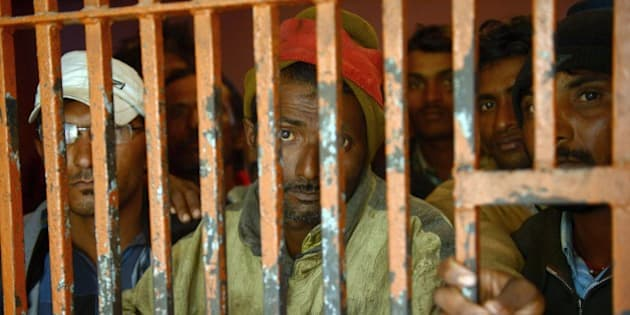 Arrested Indian fishermen stand in a police lockup in the port city of Karachi on January 22, 2015.  Pakistani marine forces have arrested 38 Indian fishermen for violating territorial waters in the Arabian Sea, police said.  AFP PHOTO / Rizwan TABASSUM        (Photo credit should read RIZWAN TABASSUM/AFP/Getty Images)