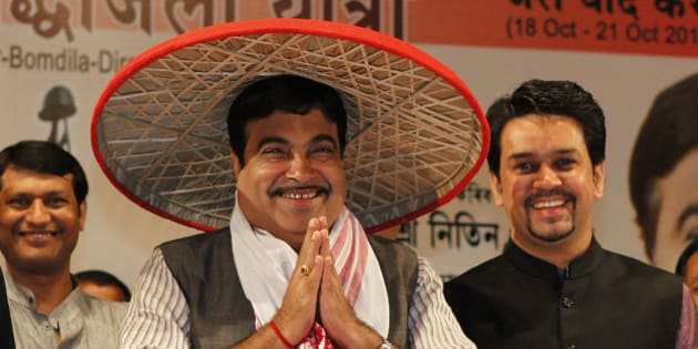 Bharatiya Janata Party  (BJP) President Nitin Gadkari wears a traditional Assamese Japi and welcomes supporters before that start of the Shahid Shraddhanjali Yatra, Journey to pay homage to Martyrs, in Gauhati, India, Thursday, Oct. 18, 2012. The BJP is carrying out the tour from Guwahati to Tawang bordering China to pay tribute to Indian soldiers who died during the 1962 India-China war. (AP Photo/Anupam Nath)