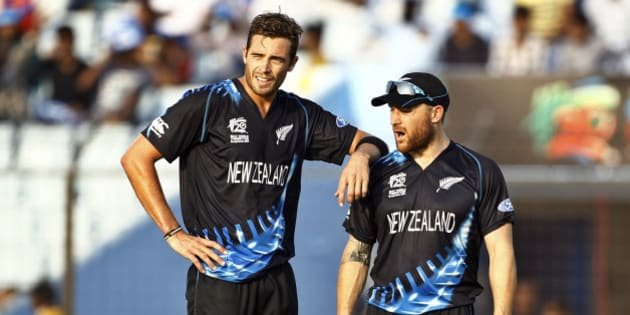 New Zealand's Tim Southee, left, stands with his team captain Brendon McCullum after taking the wicket of South Africa's Albie Morke during their ICC Twenty20 Cricket World Cup match in Chittagong, Bangladesh, Monday, March 24, 2014. (AP Photo/A.M. Ahad)