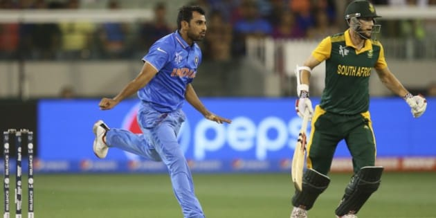 India's Mohammed Shami runs after delivering a ball during their Cricket World Cup pool B match against South Africain Melbourne, Australia, Sunday, Feb. 22, 2015. (AP Photo/Rick Rycroft)
