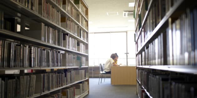 Two female student reading in library