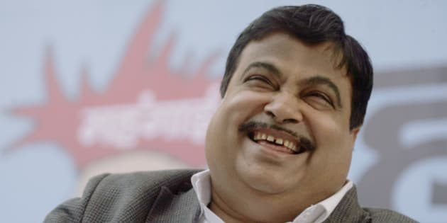 India's main opposition Bharatiya Janata Party president Nitin Gadkari laughs at a rally to protest against the rising prices of essential commodities in New Delhi, India, Wednesday, Feb. 10, 2010. India's food price rises drove a 7.3 percent jump in the headline wholesale price index in December, and inflation has begun to spread to non-food sectors as well.(AP Photo/Gurinder Osan)