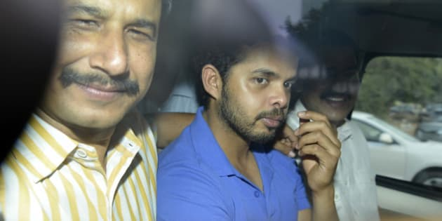 NEW DELHI, INDIA - MAY 21: Cricketer S Sreesanth being produced at Saket court in New Delhi on Tuesday for his alleged links with bookies accused of spot fixing in the IPL ongoing edition. (Photo by K Asif/India Today Group/Getty Images)