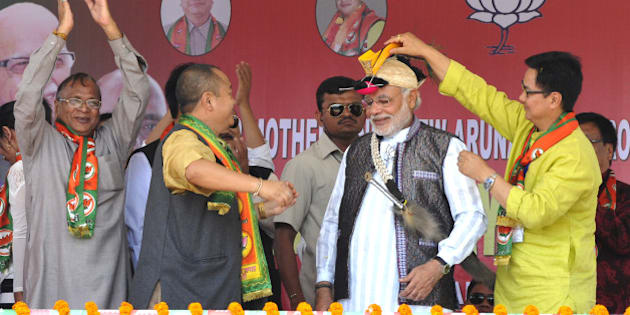 ITANAGAR, INDIA - MARCH 31: BJP Prime Ministerial candidate Narendra Modi welcomed by local leaders during campaign rally for Lok Sabha election 2014 at Indira Gandhi Park on March 31, 2014 in Itanagar, India. Taking the battle to Congress traditional base of Arunachal Pradesh, Narendra Modi attacked the Congress, saying there is no future due to their false promises. (Photo by Subrata Biswas/Hindustan Times via Getty Images)
