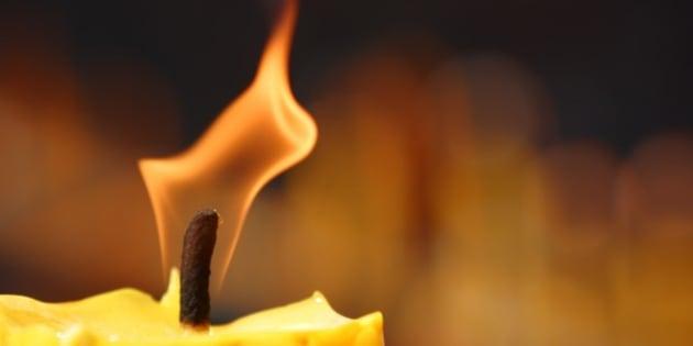 Burning symbolic candle