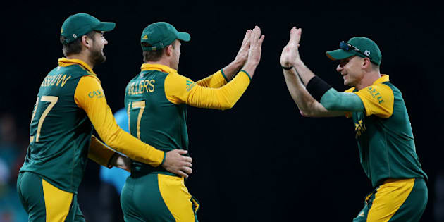South Africa's AB De Villiers is congratulated by teammates Dale Steyn, right, and Rilee Rossouw, left, after taking a catch to dismiss West Indies Jonathan Carter during their Cricket World Cup Pool B match in Sydney, Australia, Friday, Feb. 27, 2015. (AP Photo/Rick Rycroft)