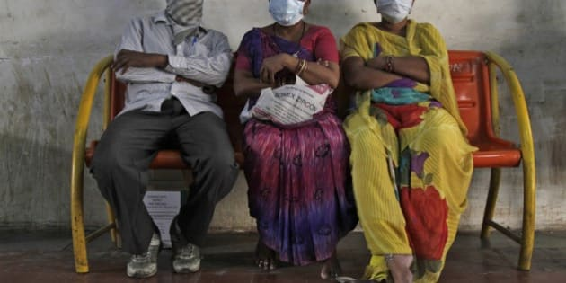 Indian relatives of swine flu patients sit outside an isolation ward for swine flu at the Civil Hospital in Ahmadabad, India, Wednesday, Feb. 25, 2015.The west Indian city has banned large public gatherings in an attempt to halt the spread of swine flu, which has claimed more than 900 lives nationwide in 11 weeks. (AP Photo/Ajit Solanki)