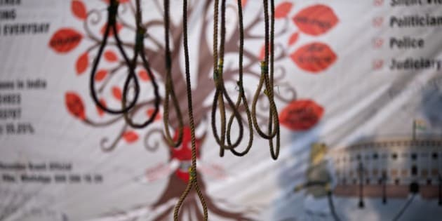Hanging ropes are displayed as part of an installation seeking death penalty for rapists on the second anniversary of the deadly gang rape of a student on a bus, in New Delhi, India, Tuesday, Dec. 16, 2014. The case sparked public outrage and helped make women's safety a common topic of conversation in a country where rape is often viewed as a woman's personal shame to bear. (AP Photo/Saurabh Das)
