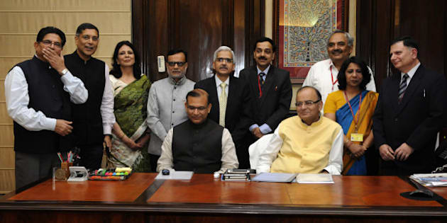 NEW DELHI, INDIA - FEBRUARY 27: Union Finance Minister Arun Jaitley with MoS for Finance Jayant Sinha and his team of officials giving final touch to the General budget 2015-16 on February 27, 2015 in New Delhi, India. Finance Minister Arun Jaitley will present tomorrow the first full year Budget of the NDA government, hyped as a 'make or break' exercise, that is widely expected to unveil sops for tax payers while pushing forward the 'Make In India' campaign. (Photo by Mohd Zakir/Hindustan Times via Getty Images)