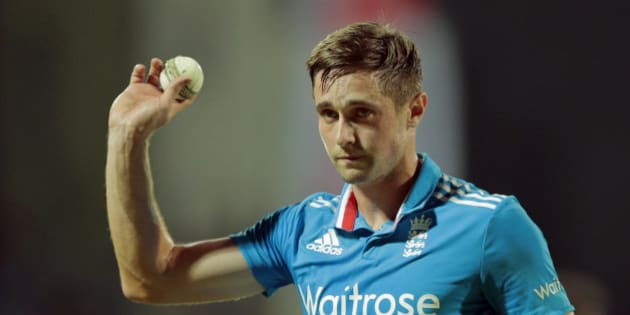 England's bowler Chris Woakes acknowledges the crowd after taking five Sri Lankan wickets during the fifth one day international cricket match between Sri Lanka and England in Pallekele , Sri Lanka, Wednesday, Dec. 10, 2014. (AP Photo/Eranga Jayawardena)