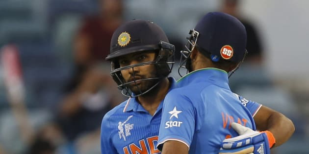 India's Virat Kohli right congratulates Rohit Sharma after he hit a half century during their Cricket World Cup Pool B match against the United Arab Emirates in Perth, Australia, Saturday, Feb 28, 2015. (AP Photo/Theron Kirkman)