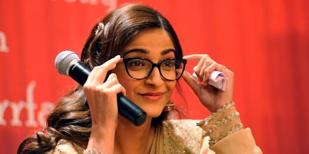 Indian Bollywood actress Sonam Kapoor attends the launch of the 'Ek Maheena Nazmon Ka' poetry compilation authored by Bollywood songwriter Irshad Kamil in Mumbai on February 3, 2015. AFP PHOTO/STR        (Photo credit should read STRDEL/AFP/Getty Images)
