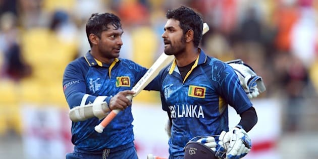 Sri Lanka batsmen Kumar Sangakkara (L) and Lahiru Thirimanne (R) celebrate after hitting the winning runs against England during their 2015 Cricket World Cup Group A match in Wellington on March 1, 2015.    AFP PHOTO / William WEST        (Photo credit should read WILLIAM WEST/AFP/Getty Images)