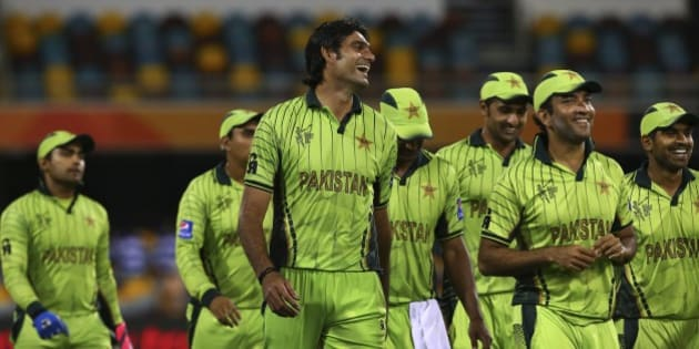 Pakistan's players smile as they walk back after defeating Zimbabwe in the Pool B Cricket World Cup match in Brisbane, Australia, Sunday, March 1, 2015. (AP Photo/Tertius Pickard)
