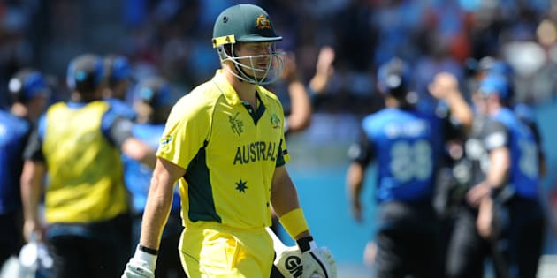 Australia's Shane Watson walks from the field after he was dismissed for 23 runs during their Cricket World Cup match against New Zealand in Auckland, New Zealand, Saturday, Feb. 28, 2015. (AP Photo Ross Setford)