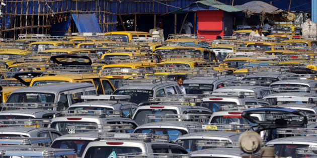 In this Tuesday, March 25, 2014 photo, traditional black-and-yellow licensed cabs and private cabs stand at a parking lot at the airport in Mumbai, India. Taxi-hailing smartphone app Uber is making a big push into Asia with the company starting operations in 18 cities in Asia and the South Pacific including Seoul, Shanghai, Bangkok, Hong Kong and five Indian cities in the last year. (AP Photo/Rajanish Kakade)