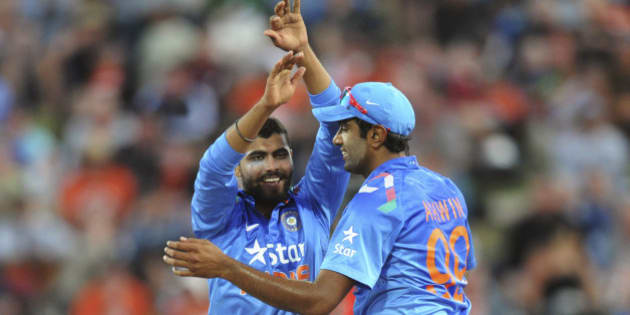 India's Ravindra Jadeja, left, celebrates with India's Ravi Ashwin after running out New Zealand's Kane Williamson for 60 in the fourth one day International cricket match at Seddon Park in Hamilton, New Zealand, Tuesday, Jan. 28, 2014. (AP Photo/SNPA, Ross Setford)  NEW ZEALAND OUT