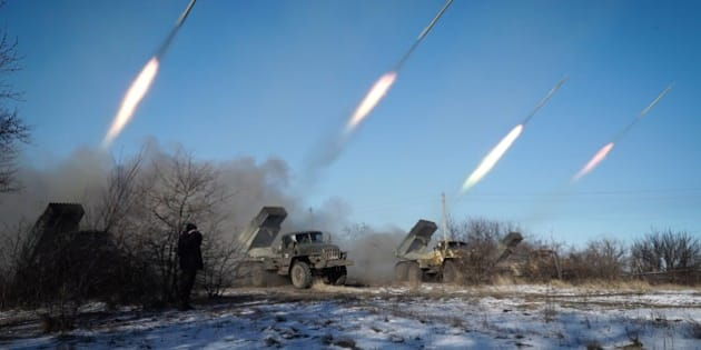 Pro-Russian rebels stationed in the eastern Ukrainian city of Gorlivka, Donetsk region, launch rockets from Grad launch vehicles on February 18, 2015. Ukrainian troops pulled out of the hotspot eastern town of Debaltseve after it was stormed by pro-Russian rebels in what the EU said was a 'clear violation' of an internationally-backed truce. AFP PHOTO / ANDREY BORODULIN        (Photo credit should read ANDREY BORODULIN/AFP/Getty Images)