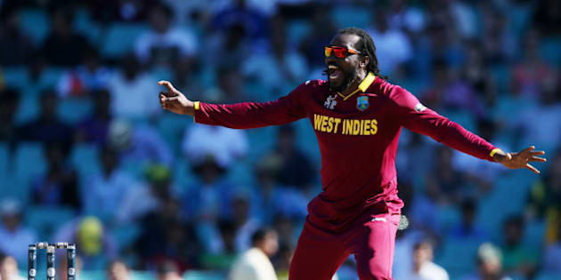 West Indies Chris Gayle celebrates after taking the wicket of South Africa's Hashim Amla, right, during their Cricket World Cup Pool B match in Sydney, Australia, Friday, Feb. 27, 2015. (AP Photo/Rick Rycroft)