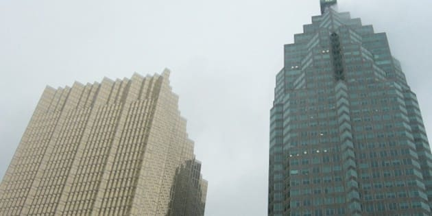 """The architectural <a href=""""http://en.wikipedia.org/wiki/Sublime_(philosophy)"""">sublime</a>  ---  In Toronto, Ontario Canada on a foggy winter day  At the top of <a href=""""http://en.wikipedia.org/wiki/Brookfield_Place"""">the building on the right</a> there is an enormous banking company logo.  The building on the left is the """"<a href=""""http://en.wikipedia.org/wiki/Royal_Bank_Plaza"""">Royal Bank Plaza</a>""""; the windows are a shiny gold colour  ---  (I've tilted the photo a little with a digital editing program -- so that the building on the left is less slanted.)"""