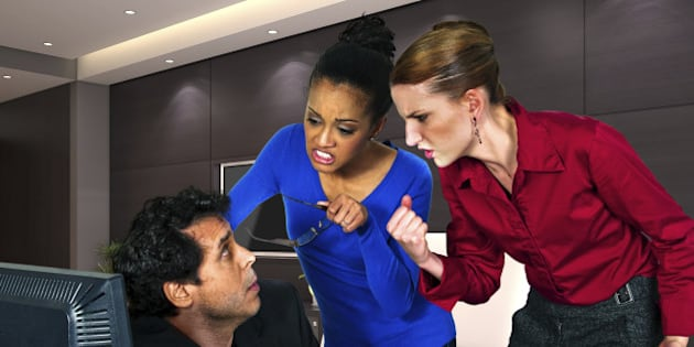 businesswomen taking out anger on guy at the office