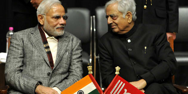 JAMMU, INDIA - MARCH 1: Prime Minister Narendra Modi along with Chief Minister Mufti Mohammad Sayeed during an oath ceremony of Mufti Mohammad Sayeed as the chief minister Of Jammu and Kashmir, on March 1, 2015 in Jammu, India. Sayeed said that he felt proud that the people in the heart of Srinagar city came out in large number to vote and thanked the 'people from across the border' for the 'conducive atmosphere' for the smooth conduct of the elections. (Photo by Nitin Kanotra/Hindustan Times via Getty Images)