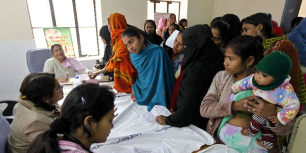 ** ADVANCE FOR USE SUNDAY, JUNE 5, 2011 AND THEREAFTER ** In this Feb. 4, 2011 photo, patients get registered for a free sterilization procedure at the Mohan Lal Gautam District Women's Hospital in Aligarh, India. Every day dozens of women line up at this hospital for a free sterilization procedure that will spare them the risk and cost of having another child. The hospital's three staff doctors race through seeing some 500 patients a day needing help with childbirth, pelvic inflammatory diseases, abortions and other treatments at subsidized costs. Each year, the cost of health care pushes some 39 million people into poverty, with patients shouldering up to 80 percent of India's medical costs. (AP Photo/Mustafa Quraishi)