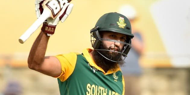 South Africa's Hashim Amla celebrates his century during the 2015 Cricket World Cup Pool B match between Ireland and South Africa in Canberra on March 3, 2015.    AFP PHOTO / Peter PARKS  --IMAGE RESTRICTED TO EDITORIAL USE - STRICTLY NO COMMERCIAL USE--        (Photo credit should read PETER PARKS/AFP/Getty Images)