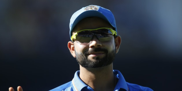 India's Virat Kohli waves to fans during their Cricket World Cup Pool B match against the United Arab Emirates in Perth, Australia, Saturday, Feb 28, 2015. (AP Photo/Theron Kirkman)